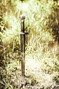 depositphotos 12415478 stock photo sword in ground1